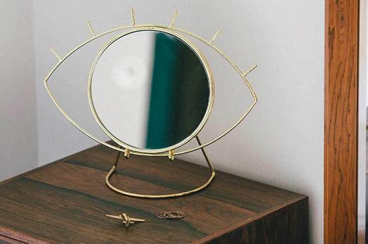Tischspiegel Auge goldfarben